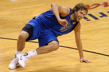MIAMI, FL - JUNE 12:  Dirk Nowitzki #41 of the Dallas Mavericks picks himself up off the court against the Miami Heat in the second half of Game Six of the 2011 NBA Finals at American Airlines Arena on June 12, 2011 in Miami, Florida. NOTE TO USER: User e
