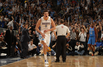 DENVER, CO - APRIL 25:  Danilo Gallinari #8 of the Denver Nuggets celebrates after hitting a three point basket against the Oklahoma City Thunder during the fourth quarter in Game Four of the Western Conference Quarterfinals in the 2011 NBA Playoffs at Pe