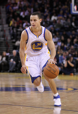 OAKLAND, CA - MARCH 25:  Stephen Curry #30 of the Golden State Warriors in action against the Toronto Raptors at Oracle Arena on March 25, 2011 in Oakland, California. NOTE TO USER: User expressly acknowledges and agrees that, by downloading and or using