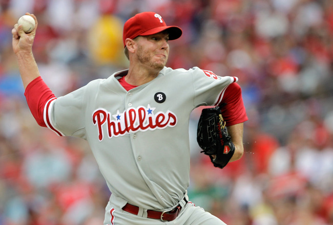 WASHINGTON, DC - AUGUST 21:  Starting pitcher Roy Halladay #34 of the Philadelphia Phillies throws to a Washington Nationals batter during the first inning at Nationals Park on August 21, 2011 in Washington, DC.  (Photo by Rob Carr/Getty Images)