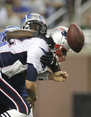 DETROIT - AUGUST 27: Cliff Avril #92 of the Detroit Lions sacks Tom Brady #12 of the New England Patriots during the first quarter of the game at Ford Field on August 27, 2011 in Detroit, Michigan.  (Photo by Leon Halip/Getty Images)
