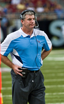 ST. LOUIS, MO - AUGUST 20: Head coach Mike Munchak of the Tennessee Titans calls in a play against the St. Louis Rams at the Edward Jones Dome on August 20, 2011 in St. Louis, Missouri.  (Photo by Ed Szczepanski/Getty Images)