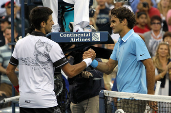 NEW YORK - SEPTEMBER 11:  (L-R) Novak Djokovic of Serbia shakes hands with Roger Federer of Switzerland after winning the men's singles semifinal match on day thirteen of the 2010 U.S. Open at the USTA Billie Jean King National Tennis Center on September