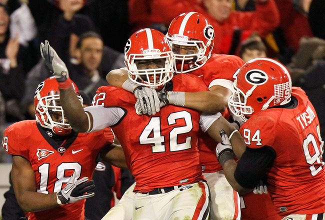 ATHENS, GA - NOVEMBER 27:  Justin Houston #42 of the Georgia Bulldogs celebrates after returning a fumble for a touchdown against the Georgia Tech Yellow Jackets at Sanford Stadium on November 27, 2010 in Athens, Georgia.  (Photo by Kevin C. Cox/Getty Ima