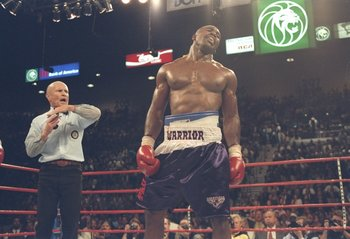28 Jun 1997: Referee Mills Lane stops the fight as Evander Holyfield grimaces in pain after Mike Tyson bit his ear during their heavyweight title fight at the MGM Grand Garden in Las Vegas, Nevada. Holyfield won the fight when Lane disqualified Tyson in t