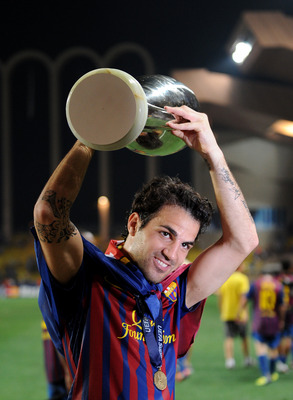 MONACO - AUGUST 26: Cesc Fabregas of FC Barcelona holds the trophy aloft during the UEFA Super Cup match between FC Barcelona and FC Porto at Louis II Stadium on August 26, 2011 in Monaco, Monaco.  (Photo by Jasper Juinen/Getty Images)