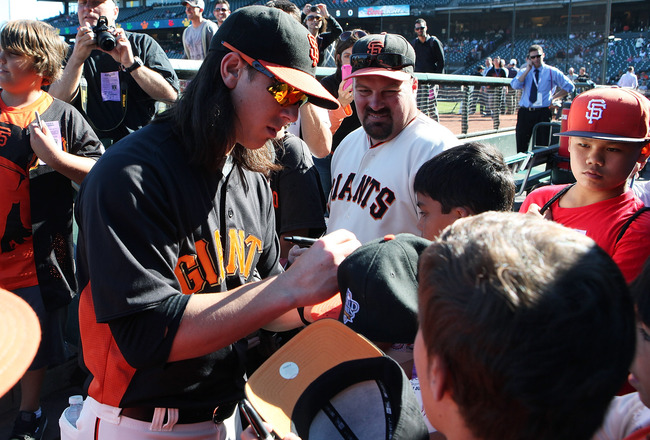SAN FRANCISCO, CA - AUGUST 27: Tim Lincecum #55 of the San Francisco Giants signs autographs for kids before the game between the Houston Astros and the San Francisco Giants at AT&T Park on August 27, 2011 in San Francisco, California.  (Photo by Tony Med
