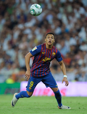 MADRID, SPAIN - AUGUST 14:  Alexis Sanchez of Barcelona runs for a ball on the break during the Super Cup first leg match between Real Madrid and Barcelona at Estadio Santiago Bernabeu on August 14, 2011 in Madrid, Spain.  (Photo by Denis Doyle/Getty Imag