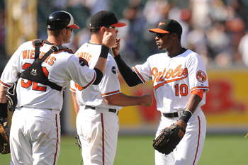 BALTIMORE, MD - AUGUST 28:  Adam Jones #10 and Matt Wieters #32 of the Baltimore Orioles celebrate after a baseball game against the New York Yankees at Oriole Park at Camden Yards on August 28, 2011 in Baltimore, Maryland.  The Orioles won 2-0.  The Orio