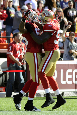 SAN FRANCISCO - AUGUST 27:  Ahmad Brooks #55 and Patrick Willis #52 of the San Francisco 49ers celebrates after Brooks runs back an interception for a touchdown against the Houston Texans in the first quarter during an NFL pre-season football game at Cand