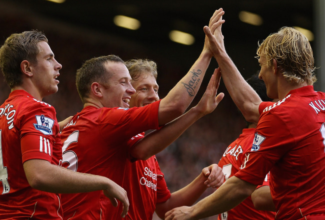 LIVERPOOL, ENGLAND - AUGUST 27:  Charlie Adam of Liverpool (second left) celebrates scoring his side's third goal with team mates during the Barclays Premier League match between Liverpool and Bolton Wanderers at Anfield on August 27, 2011 in Liverpool, E