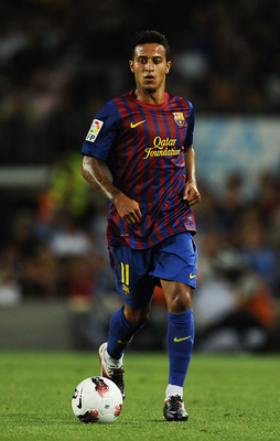 BARCELONA, SPAIN - AUGUST 22:  Thiago Alcantara of FC Barcelona runs with the ball during the Joan Gamper Trophy match between FC Barcelona and SSC Napoli at the Camp Nou Stadium on August 22, 2011 in Barcelona, Spain.  (Photo by David Ramos/Getty Images)