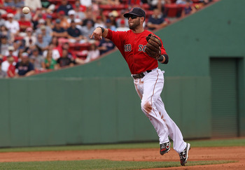 BOSTON, MA - AUGUST 27:  Dustin Pedroia #15 of the Boston Red Sox makes send the ball first against Oakland Athletics at Fenway Park August 27, 2011 in Boston, Massachusetts. (Photo by Jim Rogash/Getty Images)