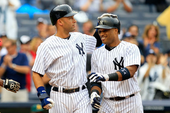 NEW YORK, NY - AUGUST 25:  Robinson Cano #24 of the New York Yankees is congratulated by his teammate Derek Jeter (L) on his grand slam home run in the 5th inning against the Oakland Athletics on August 25, 2011 at Yankee Stadium in the Bronx borough of N