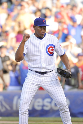 CHICAGO, IL - AUGUST 20:  Relief pitcher Carlos Marmol #49 of the Chicago Cubs pumps his fist after striking out David Freese #23 of the St. Louis Cardinals for the final out of the ninth inning at Wrigley Field on August 20, 2011 in Chicago, Illinois. Th
