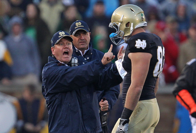 SOUTH BEND, IN - NOVEMBER 13: Head coach Brian Kelly of the Notre Dame Fighting Irish yells at Mike Ragone #83 during a game against the Utah Utes at Notre Dame Stadium on November 13, 2010 in South Bend, Indiana. Notre Dame defeated Utah 28-3.  (Photo by