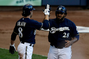 MILWAUKEE, WI - JULY 26: Prince Fielder #28 of the Milwaukee Brewers is congratulated by teammate Ryan Braun #8 after scoring against the Chicago Cubs at Miller Park on July 26, 2011 in Milwaukee, Wisconsin. (Photo by Scott Boehm/Getty Images)