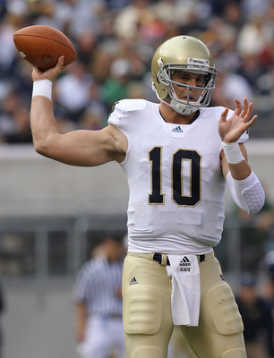 EAST RUTHERFORD, NJ - OCTOBER 23:  Dayne Crist #10 of the Notre Dame Fighting Irish passes against the Navy Midshipmen at New Meadowlands Stadium on October 23, 2010 in East Rutherford, New Jersey.  (Photo by Nick Laham/Getty Images)