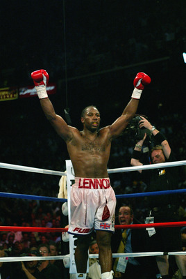 MEMPHIS, TN - JUNE 8:  Lennox Lewis celebrates after knocking out Mike Tyson in the 8th round during their WBC/IBF heavyweight championship bout on June 8, 2002 at The Pyramid in Memphis, Tennessee.  (Photo by Al Bello/Getty Images)