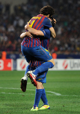 MONACO - AUGUST 26:  Cesc Fabregas (L) of FC Barcelona celebrates scoring his sides second goal with his teammates Lionel Messi during the UEFA Super Cup match between FC Barcelona and FC Porto at Louis II Stadium on August 26, 2011 in Monaco, Monaco.  (P