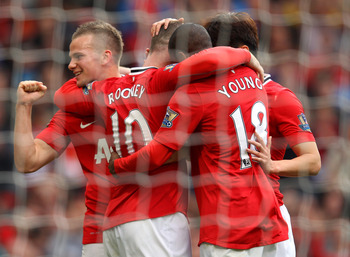 MANCHESTER, ENGLAND - AUGUST 28:  Wayne Rooney of Manchester United celebrates Tom Cleverley and Ashley Young after scoring his third goal from the penalty spot during the Barclays Premier League match between Manchester United and Arsenal at Old Trafford