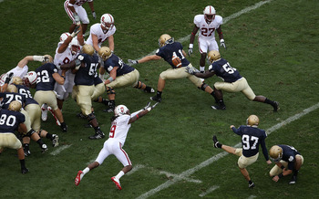SOUTH BEND, IN - SEPTEMBER 25: David Ruffer #97 of the Notre Dame Fighting Irish kicks a field goal as Richard Sherman #9 of the Stanford Cardinal tries for the block at Notre Dame Stadium on September 25, 2010 in South Bend, Indiana. Stanford defeated No
