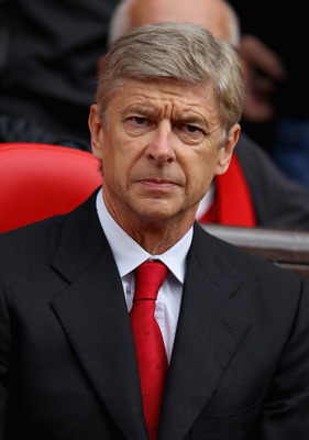 MANCHESTER, ENGLAND - AUGUST 28:  Arsenal manager Arsene Wenger looks on ahead of the Barclays Premier League match between Manchester United and Arsenal at Old Trafford on August 28, 2011 in Manchester, England.  (Photo by Alex Livesey/Getty Images)