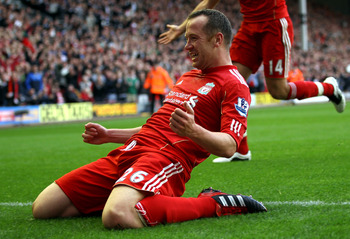 LIVERPOOL, ENGLAND - AUGUST 27:  Charlie Adam of Liverpool celebrates scoring his side's third goal during the Barclays Premier League match between Liverpool and Bolton Wanderers at Anfield on August 27, 2011 in Liverpool, England.  (Photo by Clive Bruns