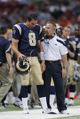 ST. LOUIS, MO - AUGUST 13: St. Louis Rams head coach Steve Spagnuolo talks to quarterback Sam Bradford #8 during the first half of the NFL preseason game against the Indianapolis Colts at Edward Jones Dome on August 13, 2011 in St. Louis, Missouri. (Photo