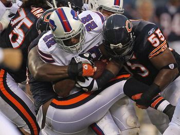 CHICAGO, IL - AUGUST 13:  Henry Melton #69 and Lance Briggs #55 of the Chicago Bears bring down Fred Jackson #22 of the Buffalo Bills during a preseason game at Soldier Field on August 13, 2011 in Chicago, Illinois.  (Photo by Jonathan Daniel/Getty Images