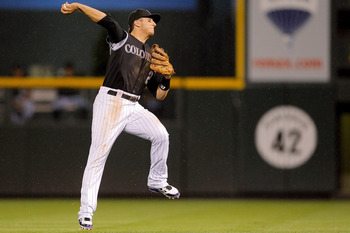DENVER, CO - AUGUST 19:  Troy Tulowitzki #2 of the Colorado Rockies makes a leaping throw to first base during the seventh inning against the Los Angeles Dodgers at Coors Field on August 19, 2011 in Denver, Colorado.  The Dodgers defeated the Rockies 8-2.