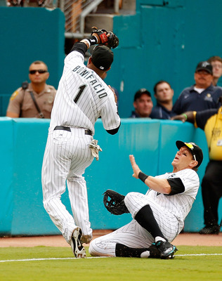 MIAMI GARDENS, FL - AUGUST 07: Emilio Bonifacio #1 of the Florida Marlins makes a catch as Logan Morrison #20 avoids a collision against the St. Louis Cardinals at Sun Life Stadium on August 7, 2011 in Miami Gardens, Florida. (Photo by Mike Ehrmann/Getty