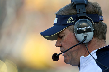 SOUTH BEND, IN - OCTOBER 30: Head coach Brian Kelly of the Notre Dame Fighting Irish watches as his team takes on the Tulsa Golden Hurricane at Notre Dame Stadium on October 30, 2010 in South Bend, Indiana. Tulsa defeated Notre Dame 28-27. (Photo by Jonat