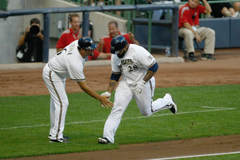 MILWAUKEE, WI - AUGUST 27:  Prince Fielder #28 of the Milwaukee Brewers is congratulated by Ed Sedar #6 as he runs the bases after hitting a home run during the game against the Chicago Cubs at Miller Park on August 27, 2011 in Milwaukee, Wisconsin. The B