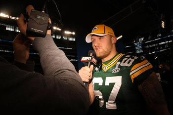ARLINGTON, TX - FEBRUARY 01:  Nick McDonald #67 of the Green Bay Packers address a member of the media during Super Bowl XLV Media Day ahead of Super Bowl XLV at Cowboys Stadium on February 1, 2011 in Arlington, Texas. The Pittsburgh Steelers will play th