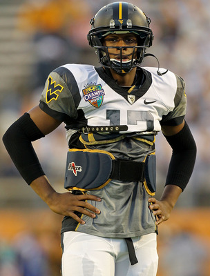ORLANDO, FL - DECEMBER 28:  Geno Smith #12 of the West Virginia Mountineers warms up during the Champs Sports Bowl against the North Carolina State Wolfpack at Florida Citrus Bowl Stadium on December 28, 2010 in Orlando, Florida.  (Photo by Mike Ehrmann/G