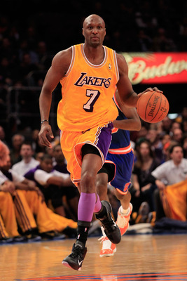 NEW YORK, NY - FEBRUARY 11:  Lamar Odum #7 of the Los Angeles Lakers dribbles against the New York Knicks at Madison Square Garden on February 11, 2011 in New York City. NOTE TO USER: User expressly acknowledges and agrees that, by downloading and/or usin