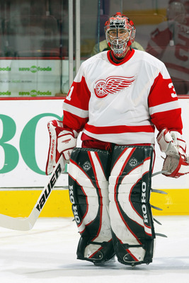 VANCOUVER, CANADA - NOVEMBER 3:  Curtis Joseph #31 of the Detroit Red Wings looks on during warmups before the game against the Vancouver Canucks on November 3, 2003 at General Motors Place in Vancouver, Canada.  The Canucks defeated the Red Wings 5-1.  (