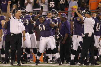 BALTIMORE, MD - AUGUST 25: Baltimore Ravens offensive coordinator Cam Cameron (L),Jason Murphy #61, and head coach John Harbaugh (R) celebrate scoring against the Washington Redskins during the second half of a preseason game at M&T Bank Stadium on August