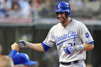 CLEVELAND, OH - AUGUST 27: Jeff Francoeur #21 of the Kansas City Royals celebrate after scoring on a two run RBI double hit by Mike Moustakas #8 (not shown) during the fourth inning against the Cleveland Indians at Progressive Field on August 27, 2011 in