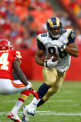 KANSAS CITY, MO - AUGUST 26: Lance Kendricks #88 of the St. Louis Rams hauls in a pass against Travis Daniels #34 of the Kansas City Chiefs during a pre-season game at Arrowhead Stadium  on August 26, 2011 in Kansas City, Missouri.  (Photo by Dilip Vishwa