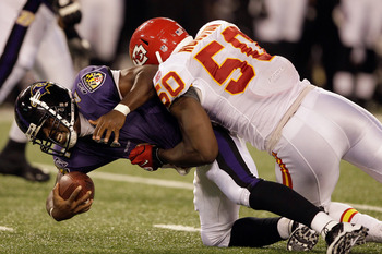 BALTIMORE, MD - AUGUST 19:  Quarterback Tyrod Taylor #2 of the Baltimore Ravens is sacked by Justin Houston #50 of the Kansas City Chiefs during the second half of a preseason game at M&T Bank Stadium on August 19, 2011 in Baltimore, Maryland. The Ravens