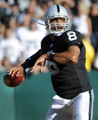 OAKLAND, CA - AUGUST 28:  Jason Campbell #8 of the Oakland Raiders drops back to pass against the New Orleans Saints in the first quarter during an NFL pre-season football game at the O.co Coliseum August 28, 2011 in Oakland, California. (Photo by Thearon