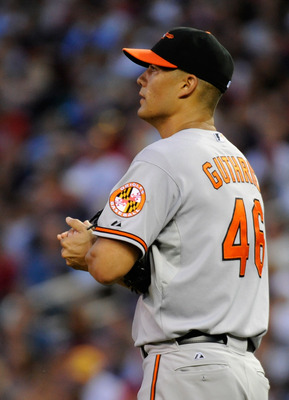 MINNEAPOLIS, MN - AUGUST 24: Jeremy Guthrie #46 of the Baltimore Orioles reacts during the third inning against the Minnesota Twins on August 24, 2011 at Target Field in Minneapolis, Minnesota. (Photo by Hannah Foslien/Getty Images)