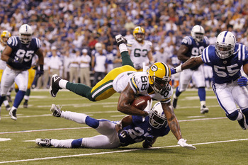 INDIANAPOLIS, IN - AUGUST 26: Jermichael Finley #88 of the Green Bay Packers dives for a first down during the first half of an NFL preseason game against the Indianapolis Colts at Lucas Oil Stadium on August 26, 2011 in Indianapolis, Indiana. (Photo by J