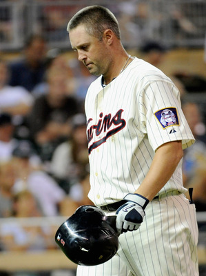 MINNEAPOLIS, MN - AUGUST 23: Michael Cuddyer #5 of the Minnesota Twins reacts to striking out against the Baltimore Orioles in the seventh inning on August 23, 2011 at Target Field in Minneapolis, Minnesota. The Orioles defeated the Twins 8-1. (Photo by H