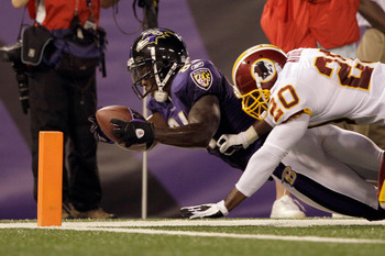 BALTIMORE, MD - AUGUST 25: Wide receiver Anquan Boldin #81 of the Baltimore Ravens is stopped short of the goal line by Oshiomogho Atogwe #20 of the Washington Redskins during the first half of a preseason game at M&T Bank Stadium on August 25, 2011 in Ba
