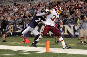 BALTIMORE, MD - AUGUST 25: Tim Hightower #39 of the Washington Redskins scores a touchdown against Tom Zbikowski #28 of the Baltimore Ravens during the first half of a preaseason game at M&T Bank Stadium on August 25, 2011 in Baltimore, Maryland.  (Photo