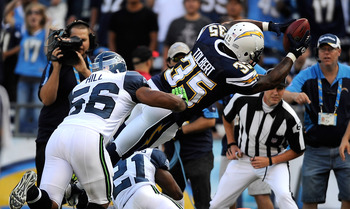 SAN DIEGO, CA - AUGUST 11:  Mike Tolbert #35 of the San Diego Chargers dives into the endzone over Kelly Jennings #21 of the Seattle Seahawks to score an eight-yard touchdown reception in the first quarter during the NFL preseason game at Qualcomm Stadium