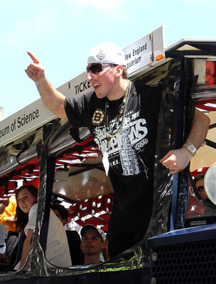 BOSTON, MA  - JUNE 18:  Brad Marchand of the Boston Bruins reacts to cheers during a Stanley Cup victory parade on June 18, 2011 in Boston, Massachusetts.  (Photo by Jim Rogash/Getty Images)